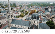 Купить «Aerial view of ancient Church Notre-Dame in French commune of Chateauroux on background with peculiar townscape», видеоролик № 29752508, снято 7 октября 2018 г. (c) Яков Филимонов / Фотобанк Лори