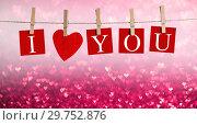 Купить «Pegs and I LOVE YOU words on rope», фото № 29752876, снято 10 января 2017 г. (c) Иван Михайлов / Фотобанк Лори