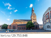 Купить «Riga, Latvia - July 29, 2017: Beautiful evening view on Dome Square and Evangelical Lutheran Riga Dome Cathedral at the historical center of the old town. It is one of the most recognizable landmarks.», фото № 29753848, снято 29 июля 2017 г. (c) Алексей Ширманов / Фотобанк Лори