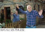 Купить «Irritated farmer with wife berating him», фото № 29754232, снято 15 декабря 2018 г. (c) Яков Филимонов / Фотобанк Лори