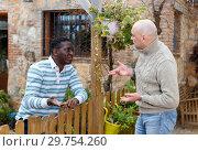 Купить «Smiling neighbors discussing», фото № 29754260, снято 15 декабря 2018 г. (c) Яков Филимонов / Фотобанк Лори