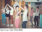Купить «Tweens practicing vigorous dance in class», фото № 29755800, снято 3 марта 2018 г. (c) Яков Филимонов / Фотобанк Лори