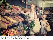Купить «Glad mother with daughter shopping various veggies», фото № 29756112, снято 27 мая 2019 г. (c) Яков Филимонов / Фотобанк Лори