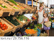 Купить «Portrait of glad woman and kid shopping», фото № 29756116, снято 27 июня 2019 г. (c) Яков Филимонов / Фотобанк Лори