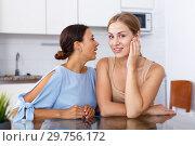 Купить «Young girl telling gossip her friend», фото № 29756172, снято 29 августа 2018 г. (c) Яков Филимонов / Фотобанк Лори