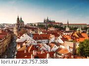 Купить «View of Prague rooftops, St. Vitus Cathedral and St. Nicholas Cathedral. Czech republic», фото № 29757388, снято 5 сентября 2014 г. (c) Наталья Волкова / Фотобанк Лори