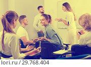 Купить «Students communicating during recess between lectures», фото № 29768404, снято 5 октября 2017 г. (c) Яков Филимонов / Фотобанк Лори