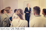 Купить «Female teacher lecturing to students at auditorium», фото № 29768416, снято 5 октября 2017 г. (c) Яков Филимонов / Фотобанк Лори