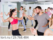 Купить «dancing couples of smiling men and women learning swing», фото № 29768484, снято 9 октября 2017 г. (c) Яков Филимонов / Фотобанк Лори