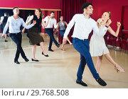 Купить «Young people dancing rock-and-roll in pairs», фото № 29768508, снято 24 мая 2017 г. (c) Яков Филимонов / Фотобанк Лори
