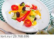 Купить «Delicious salad with tomatoes, cucumber, feta cheese and paprika», фото № 29768696, снято 23 марта 2019 г. (c) Яков Филимонов / Фотобанк Лори