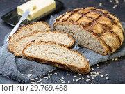 Купить «Artisanal rustic bread with seeds close-up», фото № 29769488, снято 21 января 2019 г. (c) Марина Сапрунова / Фотобанк Лори