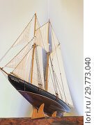 Купить «Wooden scale model of the Bluenose schooner displayed on a wooden beam on the upper floor inside an old circa 1850 Canadiana cottage style home, Quebec...», фото № 29773040, снято 15 июля 2016 г. (c) age Fotostock / Фотобанк Лори