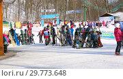 Купить «People at the mountain ski resort in winter sunny day», видеоролик № 29773648, снято 23 января 2019 г. (c) FotograFF / Фотобанк Лори