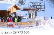 Купить «Chairlift in mountain ski resort in winter sunny day», видеоролик № 29773660, снято 23 января 2019 г. (c) FotograFF / Фотобанк Лори