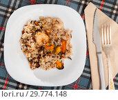 Купить «Top view of rice with shrimps and mussels», фото № 29774148, снято 14 декабря 2018 г. (c) Яков Филимонов / Фотобанк Лори