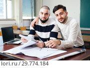 Купить «Portrait of two positive male students», фото № 29774184, снято 17 декабря 2018 г. (c) Яков Филимонов / Фотобанк Лори
