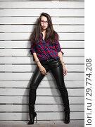 Купить «Nice young brunette posing in the studio.», фото № 29774208, снято 26 апреля 2016 г. (c) Сергей Сухоруков / Фотобанк Лори