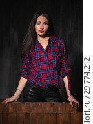 Купить «Portrait of a attractive woman posing standing.», фото № 29774212, снято 26 апреля 2016 г. (c) Сергей Сухоруков / Фотобанк Лори