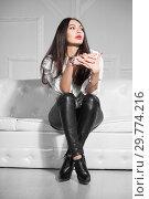 Купить «Lovely woman posing sitting.», фото № 29774216, снято 26 апреля 2016 г. (c) Сергей Сухоруков / Фотобанк Лори