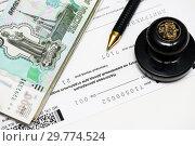 Купить «Пора платить налоги. Шариковая ручка, печать предприятия, тысячные купюры и налоговая декларация на вменённый доход», эксклюзивное фото № 29774524, снято 16 января 2019 г. (c) Игорь Низов / Фотобанк Лори