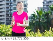 Sporty woman in pink T-shirt is jogging. Стоковое фото, фотограф Яков Филимонов / Фотобанк Лори