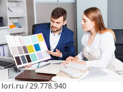 Купить «Competent seller in showroom helping young female client to choose furniture materials for her apartment», фото № 29778940, снято 9 апреля 2018 г. (c) Яков Филимонов / Фотобанк Лори