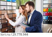 Купить «Competent seller in showroom helping young female client to choose furniture materials for her apartment», фото № 29778944, снято 9 апреля 2018 г. (c) Яков Филимонов / Фотобанк Лори