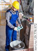 Купить «Professional plasterer is ready to plaster the walls», фото № 29778972, снято 3 июня 2017 г. (c) Яков Филимонов / Фотобанк Лори