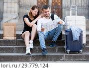 Купить «tourists with map at stairs», фото № 29779124, снято 25 мая 2017 г. (c) Яков Филимонов / Фотобанк Лори