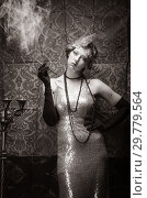Купить «Girl in an evening dress with a cigarette mouthpiece. Studio portrait in retro style, toned in sepia», фото № 29779564, снято 27 декабря 2018 г. (c) Вадим Орлов / Фотобанк Лори