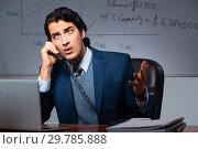 Купить «Financial specialist working late in the office», фото № 29785888, снято 25 октября 2018 г. (c) Elnur / Фотобанк Лори
