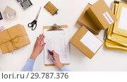 Купить «woman with parcels and clipboard at post office», видеоролик № 29787376, снято 19 января 2019 г. (c) Syda Productions / Фотобанк Лори