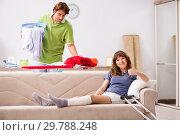 Купить «Husband helping leg injured wife in housework», фото № 29788248, снято 4 октября 2018 г. (c) Elnur / Фотобанк Лори