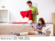 Купить «Husband helping leg injured wife in housework», фото № 29788252, снято 4 октября 2018 г. (c) Elnur / Фотобанк Лори