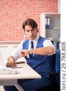 Купить «Young handsome employee working in the office», фото № 29788808, снято 12 сентября 2018 г. (c) Elnur / Фотобанк Лори