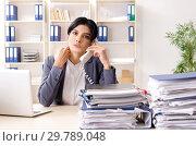 Купить «Middle aged businesslady unhappy with excessive work», фото № 29789048, снято 15 ноября 2018 г. (c) Elnur / Фотобанк Лори