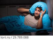Купить «Young handsome man suffering from insomnia in bed», фото № 29789088, снято 18 сентября 2018 г. (c) Elnur / Фотобанк Лори