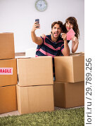 Купить «Young family moving to new house apartment», фото № 29789256, снято 21 сентября 2018 г. (c) Elnur / Фотобанк Лори