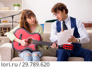 Young woman during music lesson with male teacher. Стоковое фото, фотограф Elnur / Фотобанк Лори