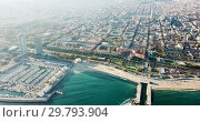 Купить «Aerial view of seaside area of Barcelona with harbor on sunny day, Catalonia, Spain», видеоролик № 29793904, снято 16 ноября 2018 г. (c) Яков Филимонов / Фотобанк Лори