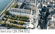 Купить «View from drone of Medieval Eglise Saint-Nicolas, St. Nicolas church, built in 12th century in Blois, France», видеоролик № 29794072, снято 25 октября 2018 г. (c) Яков Филимонов / Фотобанк Лори