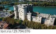 Купить «Aerial view of medieval fortified Chateau de Tarascon and Rhone river at sunny day», видеоролик № 29794076, снято 24 октября 2018 г. (c) Яков Филимонов / Фотобанк Лори