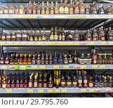 Купить «Showcase alcoholic beverages at the chain hypermarket», фото № 29795760, снято 24 марта 2018 г. (c) FotograFF / Фотобанк Лори