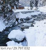 Купить «Небольшая холодная горная река Аманауз в Домбае. Пасмурный зимний день в курортном поселке», фото № 29797032, снято 16 декабря 2018 г. (c) Наталья Гармашева / Фотобанк Лори