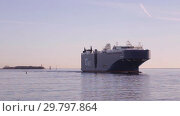 Купить «Largest vehicles carrier AUTO ENERGY leaves the port of St. Petersburg and goes along fairway in Gulf of Finland», видеоролик № 29797864, снято 4 ноября 2018 г. (c) Юлия Бабкина / Фотобанк Лори