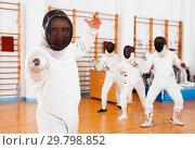 Купить «Sporty young man fencer practicing effective fencing techniques in training room», фото № 29798852, снято 11 июля 2018 г. (c) Яков Филимонов / Фотобанк Лори
