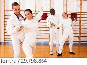Купить «men and women fencers posing with foils together», фото № 29798864, снято 11 июля 2018 г. (c) Яков Филимонов / Фотобанк Лори