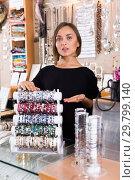 Купить «woman offering to buy stylish bracelets», фото № 29799140, снято 16 октября 2017 г. (c) Яков Филимонов / Фотобанк Лори