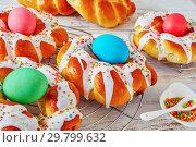 Купить «Easter Bread wreaths glazed around dyed eggs», фото № 29799632, снято 20 января 2019 г. (c) Oksana Zh / Фотобанк Лори